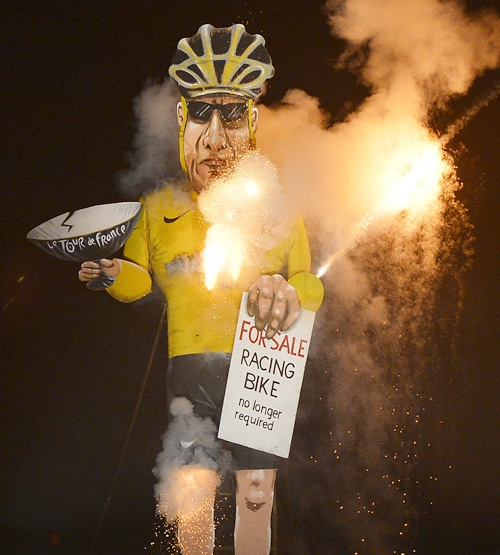 An effigy of US cyclist Lance Armstrong burns