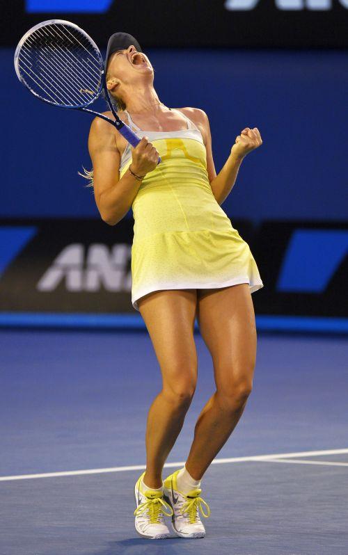 Maria Sharapova of Russia celebrates defeating Venus Williams of the U.S. during their women's singles match at the Australian Open tennis tournament