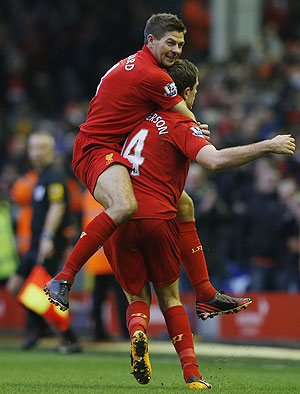 Liverpool's Jordan Henderson (right) and teammate Steven Gerrard celebrate after scoring during their English Premier League match against Norwich City on Saturday