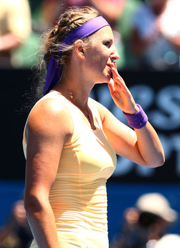 Victoria Azarenka of Belarus celebrates winning her third round match against Jamie Hampton of the United States