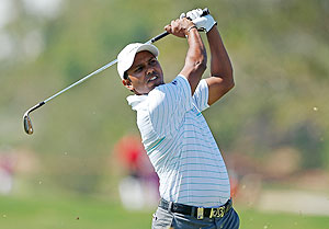 SSP Chowrasia of India watches a shot on the 18th hole during the third round of the Abu Dhabi HSBC Golf Championship at Abu Dhabi Golf Club on Saturday