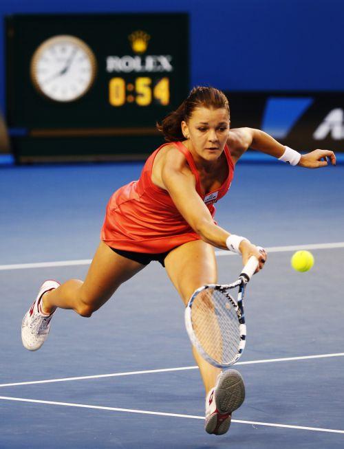 Agnieszka Radwanska of Poland hits a return to Ana Ivanovic of Serbia