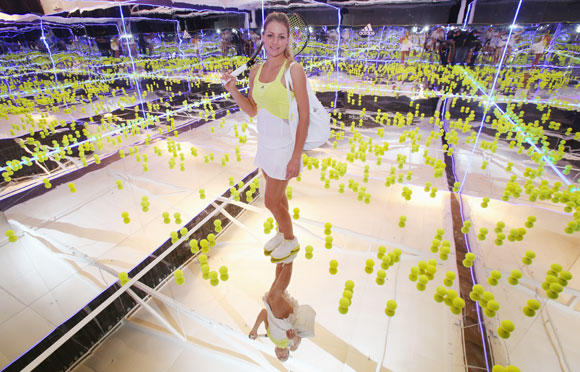 Maria Kirilenko of Russia poses on a mirror court at the Adidas by Stella McCartney media launch