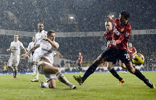Tottenham Hotspur's Michael Dawson (Left) misses a shot on goal