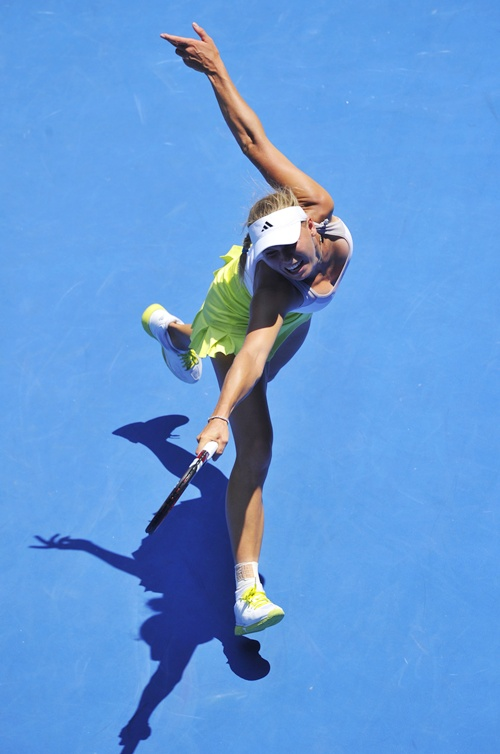 Caroline Wozniacki of Denmark hits a return