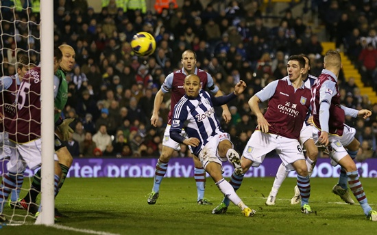 Peter Odemwingie of West Bromwich Albion scores their second goal