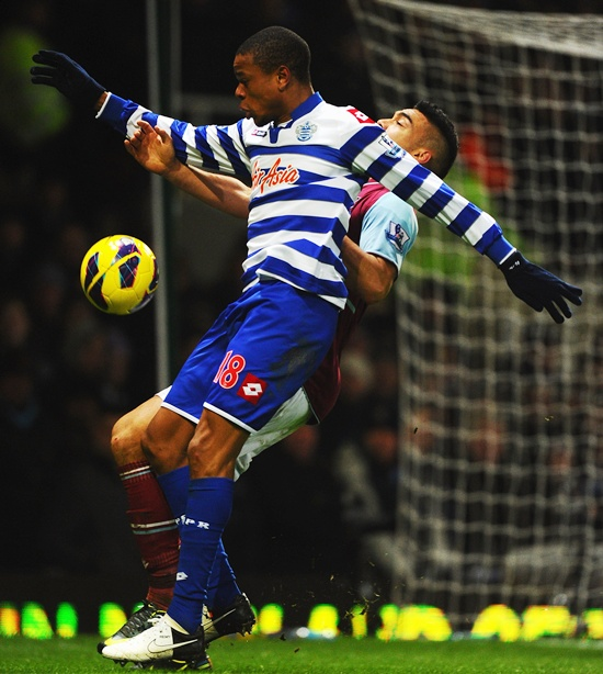 Loic Remy of Queens Park Rangers controls the ball ahead of Winston Reid