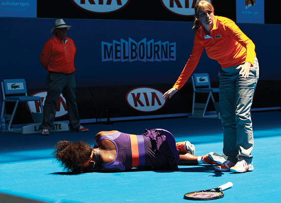 Serena Williams lies on the ground