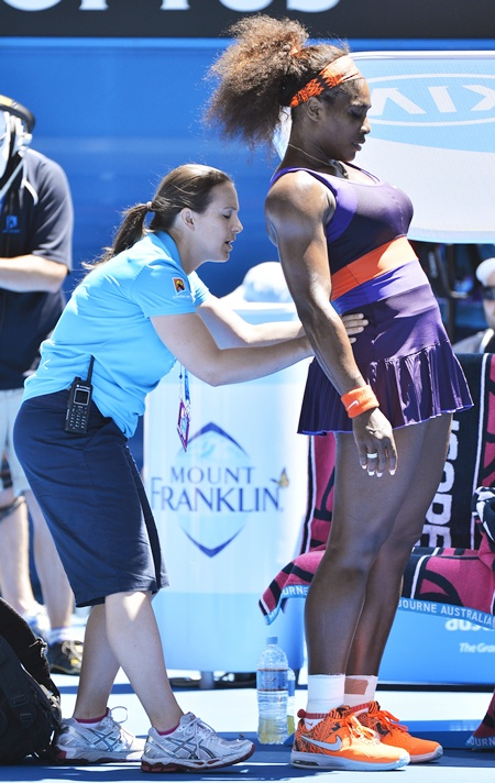 Serena Williams of the US receives treatment