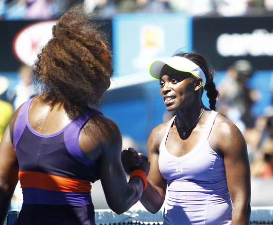 Sloane Stephens (right) shakes hands with Serena Williams