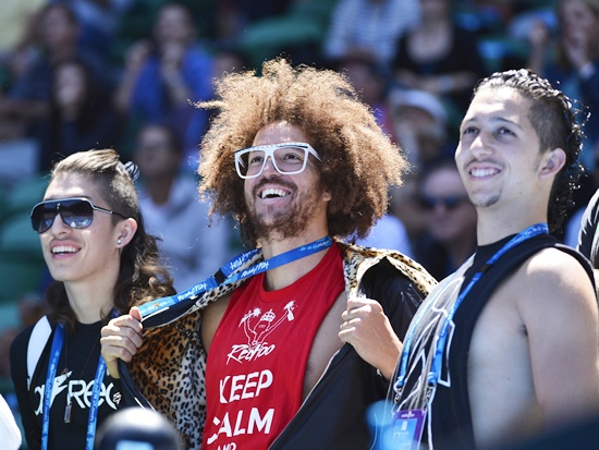 LMFAO musician Redfoo (centre) boyfriend of Victoria Azarenka of Belarus, displays his vest-top