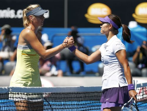 Li Na of China (R) shakes hands with Maria Sharapova of Russia after defeating her in their women's singles semi-final match