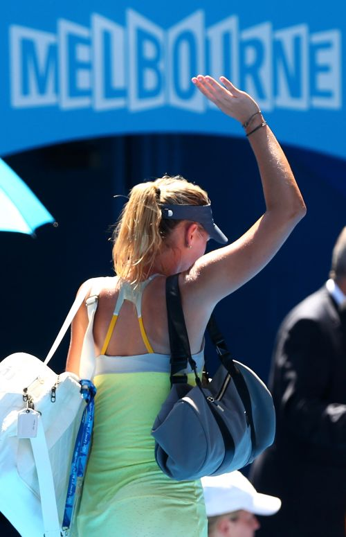 Maria Sharapova of Russia leaves the court after losing her semi-final match against Na Li of China