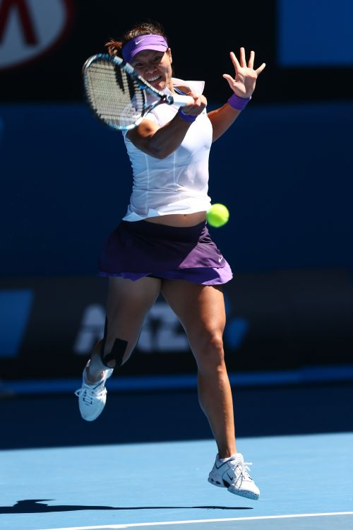 Na Li of China plays a forehand in her semifinal match against Maria Sharapova of Russia