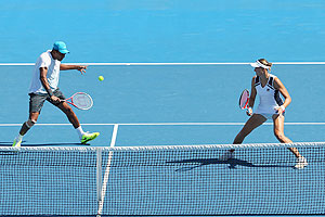 Nadia Petrova of Russia and Mahesh Bhupathi of India in action during their mixed doubles quarter-final against Jarmila Gajdosova and Matthew Ebden of Australia on Thursday