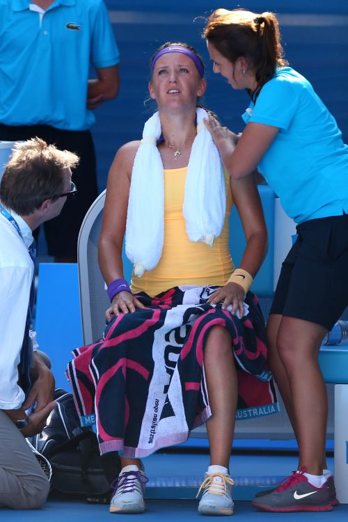 Victoria Azarenka of Belarus receives medical attention in her semifinal match against Sloane Stephens of the United States