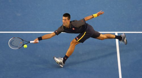 Novak Djokovic of Serbia plays a forehand in his semifinal match against David Ferrer of Spain