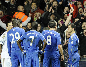Chelsea's Eden Hazard (right) is sent off during their English League Cup semi-final second leg match against Swansea on Wednesday