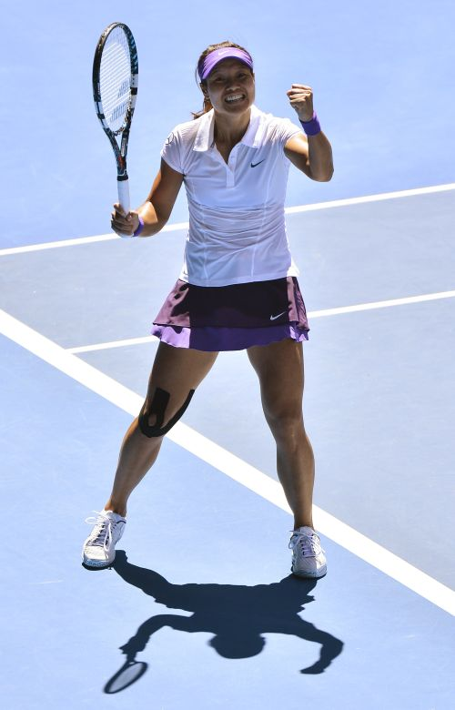 Li Na of China celebrates defeating Maria Sharapova of Russia in their women's singles semi-final match at the Australian Open