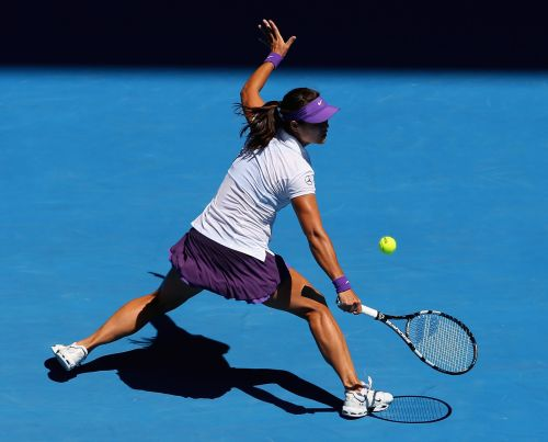Na Li of China plays a backhand in her Semifinal match against Maria Sharapova of Russia
