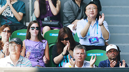 Li Na's husband Jiang Shan (left) and coach Carlos Rodriguez (right) watch her women's singles semi-final against Maria Sharapova on Thursday