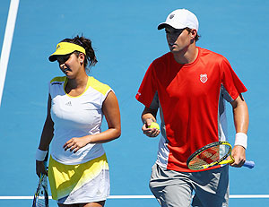 Sania Mirza of India and Bob Bryan of the United States of America talk tactics in their mixed doubles quarter-final on Thursday
