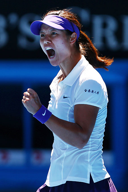 Na Li celebrates a point during her semi-final against Maria Sharapova on Thursday