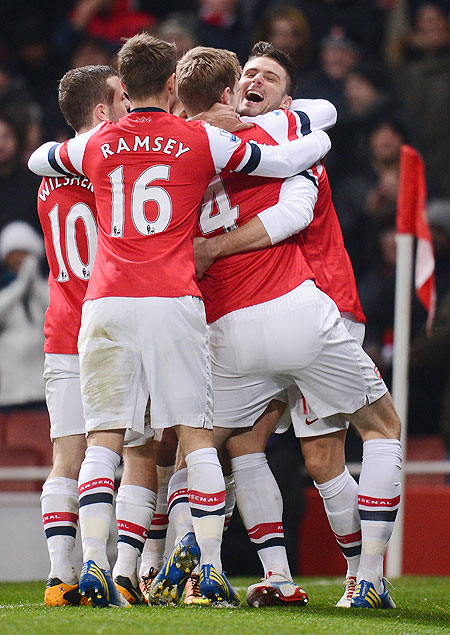 Arsenal's Olivier Giroud celebrates with teammates after scoring against West Ham United at Emirates Stadium on Wednesday
