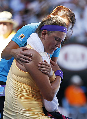 Victoria Azarenka of Belarus receives medical treatment during a break in her women's singles semi-final match against Sloane Stephens on Thursday