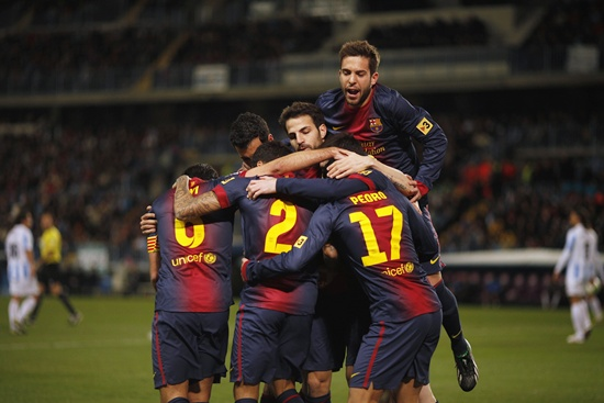 Barcelona's Pedro Rodriguez (centre) is congratulated by his teammates