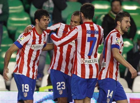 Atletico Madrid's Diego Costa (left) is congratulated by teammates