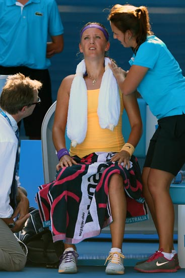 Victoria Azarenka receives medical attention during her Semi-final match against Sloane Stephens of the US