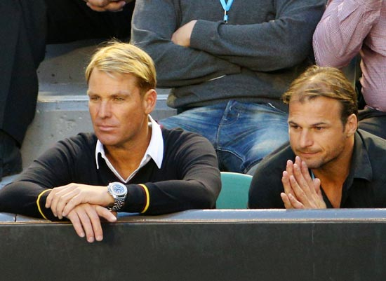 Former Australia cricketer Shane Warne (left) with former Australian Football League (AFL) player Aaron Hamill
