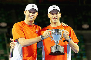 Bob Bryan and Mike Bryan of the United States celebrate with the championship trophy after winning their doubles final against Robin Haase of the Netherlands and Igor Sijsling of the Netherlands at the Australian Open on Saturday