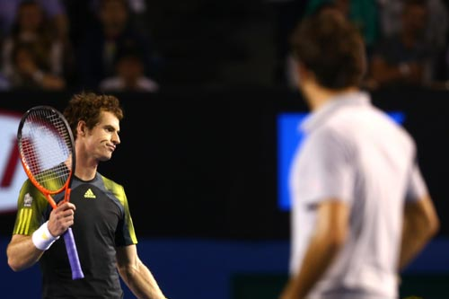 Andy Murray of Great Britain questions a line call in his semifinal match against Roger Federer of Switzerland