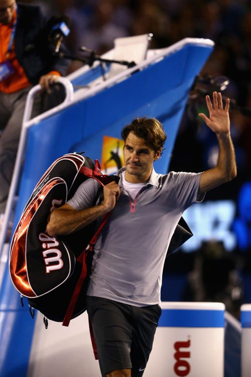 Roger Federer of Switzerland leaves the court after losing his semifinal match against Andy Murray
