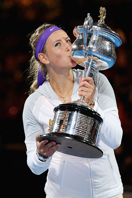 Victoria Azarenka of Belarus poses with the Daphne Akhurst Memorial Cup after winning the 2013 Australian Open on Satu