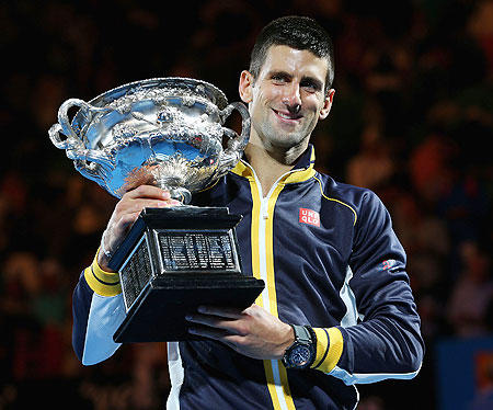 Novak Djokovic holds the Norman Brookes Challenge Cup after the Australian Open final against Andy Murray on Sunday