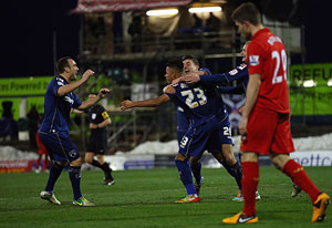 Reece Wabara of Oldham Athletic celebrates scoring his team's third goal during the FA Cup match against Liverpool at Boundary Park on Sunday