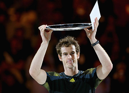 Andy Murray of Great Britain holds the runner up plate after losing the final against Novak Djokovic