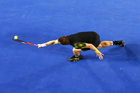 Andy Murray plays a backhand during the final against Novak Djokovic