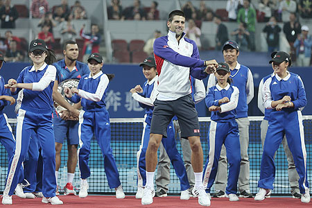 Novak Djokovic dances to the 'Gangnam Style' after defeating Jo-Wilfried Tsonga during the final of the China Open in October