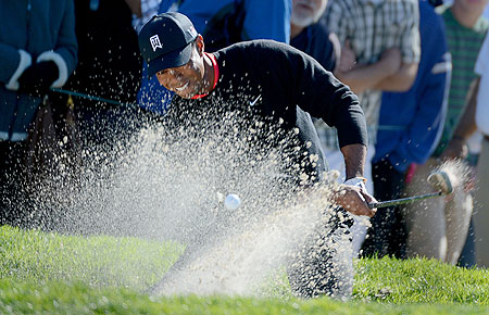 Tiger Woods hits out of the 11th green bunker en route to his -14 under victory during the Final Round at the Farmers Insurance Open at Torrey Pines Golf Course on Monday