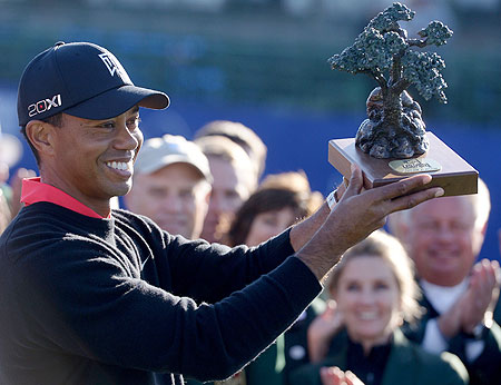 Tiger Woods with the trophy after winning the PGA Tour title at Torrey Pines in California on Monday