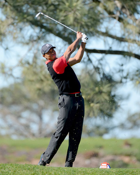 Tiger Woods hits off the 8th tee during the Final Round at the Farmers Insurance Open at Torrey Pines Golf Course on Sunday