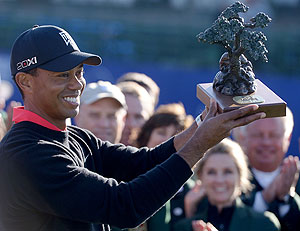 Tiger Woods holds the winner's trophy after winning his 75th PGA tour title at the Torrey Pines Golf Course in La Jolla, California on Monday