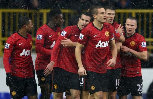 Manchester United players after scoring a goal