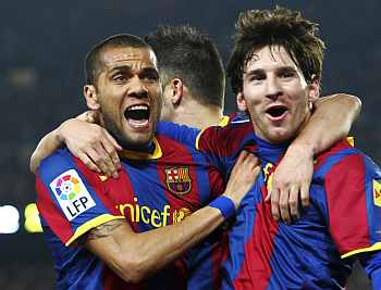 Barca's Lionel Messi with Dani Alves