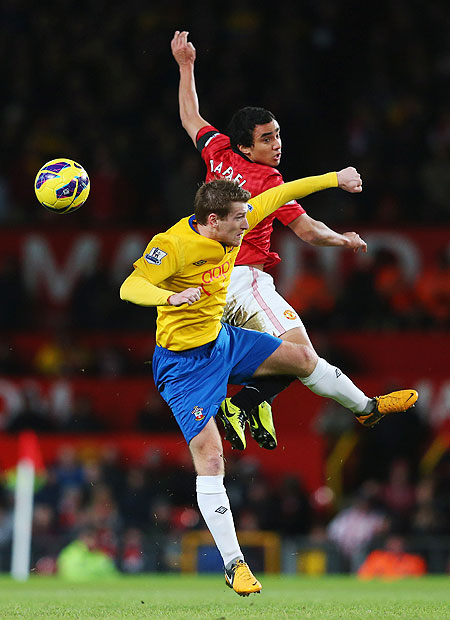 Rafael da Silva of Manchester United and Steven Davis of Southampton are involved in an aerial duel during their match on Wednesday