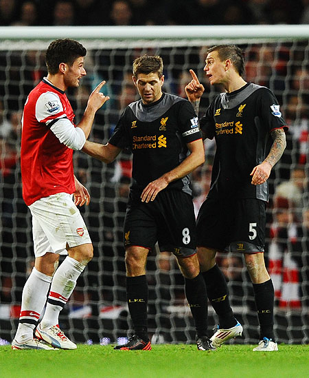 Liverpool's Steven Gerrard tries to settle a squabble between Olivier Giroud of Arsenal (left) and teammate Daniel Agger on Wednesday